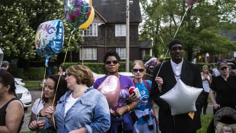 People hold balloons during a community balloon-release service in kidnapping victim Michelle Knight's honor.