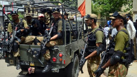 Pakistani army soldiers stand guard outside a distribution center for election materials in Karachi on May 10, 2013. The nation's military will have 75,000 troops out around the country.