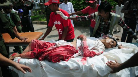 Volunteers move an injured boy to a hospital following a bomb explosion in Karachi on May 11.