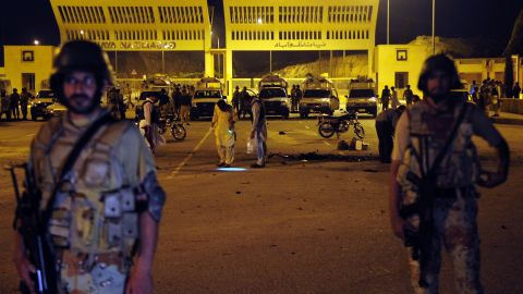 Soldiers cordon off the site of a bomb explosion in Karachi on Saturday, May 11. Four blasts hit Karachi as people voted, causing 14 deaths and dozens of injuries.