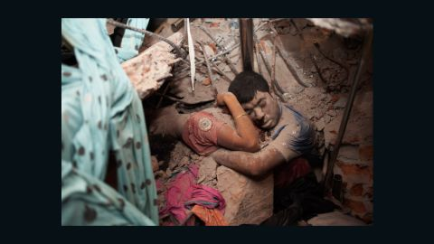 Two bodies clutch each other in the rubble on Thursday, April 25.