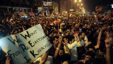 Khan's supporters stage a protest in Karachi on Sunday. Khan said his party would submit a report on alleged vote-rigging.