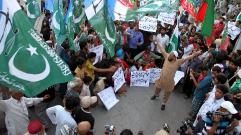 Supporters of politician Imran Khan shout slogans over allegations of election fraud during a protest in Hyderabad, Pakistan, on Monday, May 13.