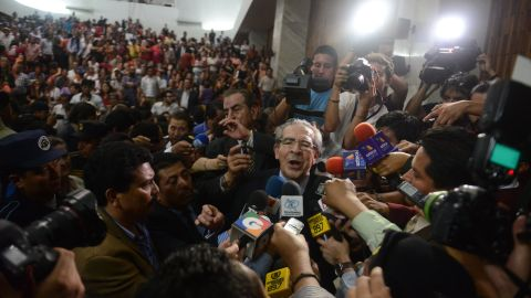 """Montt talks to the media in Guatemala City on May 10, 2013, after being convicted on charges of genocide allegedly committed during his regime in 1982-83. It was """"the first time, anywhere in the world,"""" that a former head of state was being tried for genocide by a national tribunal, according to the United Nations. <a href=""""http://www.cnn.com/2013/05/21/world/americas/guatemala-genocide-trial/index.html"""" target=""""_blank"""">The conviction was overturned</a> 10 days later, however, and Guatemala's Constitutional Court ordered a retrial."""