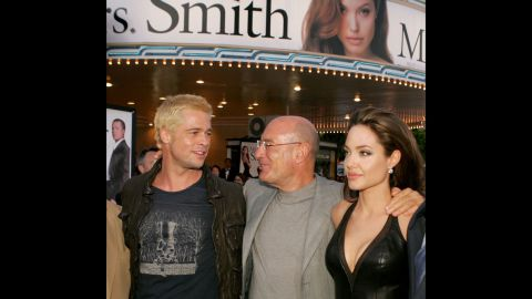 """Producer Arnon Milchan centers Jolie and Pitt at the premiere of """"Mr. & Mrs. Smith"""" in June 2005."""