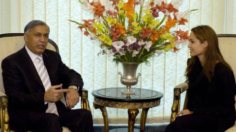 As part of her role as goodwill ambassador, Jolie speaks with Pakistani Prime Minister Shaukat Aziz in Islamabad, Pakistan, in May 2005.
