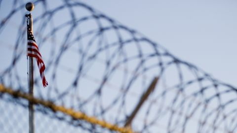 This image reviewed by the US military shows the flag and barbed wire within the 'Camp Six' detention facility of the Joint Detention Group at the US Naval Station in Guantanamo Bay, Cuba, January 19, 2012.