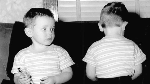 """By the '50s, denim had become popular with everyday Americans, children included. The grandmother of <a href=""""http://ireport.cnn.com/docs/DOC-965623"""">these twin boys</a> """"thought it was time they looked like little boys instead of babies,"""" said iReporter Janie Lambert, whose husband, right, was about 3 years old in this 1952 photo.  The pants were a deep blue denim (no prewash in those days)."""