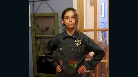 """Just about every '80s kid in America <a href=""""http://ireport.cnn.com/docs/DOC-966292"""">had a jean jacket</a>, preferably with patches, pins or rhinestones. In 1983, when Beth Barret was 13, her mom bought her this jacket and her grandmother sewed the patches. Barret's daughter, shown here in May, often wears it now."""