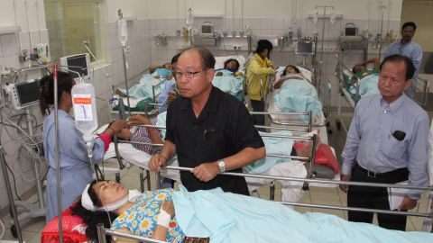 Cambodia's Minister of Health Mam Bunheng visits injured workers  at a hospital in Kampong Speu Province.