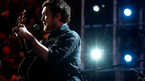 """""""American Idol"""" started its new season in early January, but not all is well with past winner Phillip Phillips. In January 2015, the season 11 winner filed a claim against 19 Entertainment, the show's producers, saying he was """"manipulated"""" into accepting jobs. <a href=""""http://www.hollywoodreporter.com/thr-esq/american-idol-winner-files-bold-767088"""" target=""""_blank"""" target=""""_blank"""">The Hollywood Reporter wrote</a> that he's trying to void various agreements."""