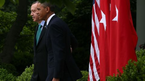 U.S. President Barack Obama and PM Recep Tayyip Erdogan of Turkey walk into the White House Rose Garden, May 16, 2013.