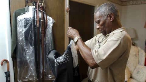 """Eugene Arms, another member of the Class of 1963, gets his suit ready for Friday night's prom. Arms said he attended civil rights rallies in Birmingham as a teenager, but not the pivotal Children's March, when hundreds of children, some as young as 6, left school to march in opposition to segregation. Authorities responded with fire hoses and dogs. """"All we did was give up prom,"""" he said."""