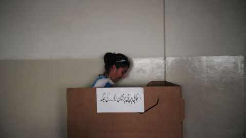 A Pakistani woman casts her ballot in Karachi on May 19.