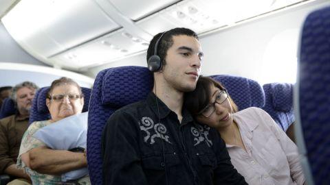 Alex Gilbert and Rebecca Davila watch a film during a flight on a Boeing 787Dreamliner.