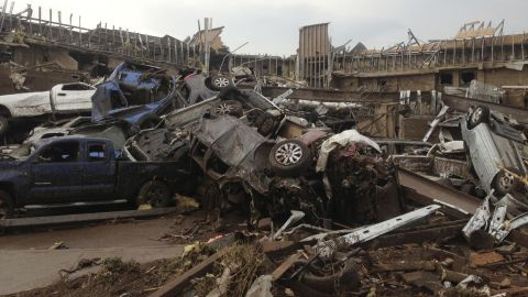 Extensive damage from the tornado destroyed cars and demolished structures in Moore on May 20.