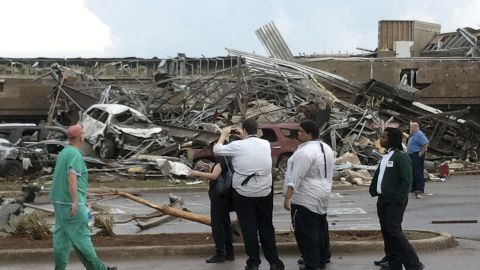 Onlookers stop to view a portion of the destruction left behind on May 20 in Moore.