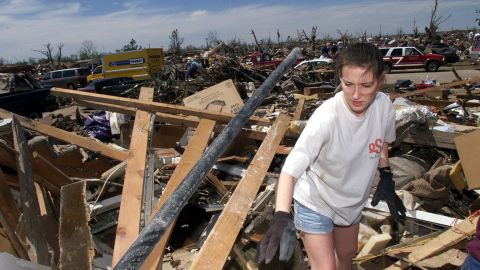"""Amber Landis walks among the remains of her home in Moore, Oklahoma, which was destroyed by an EF5 tornado on May 3, 1999. Forty-six people were killed in a <a href=""""http://www.cnn.com/2013/05/20/us/oklahoma-1999-tornado/index.html"""">string of tornadoes</a> that tore through Oklahoma on May 3, 1999, the strongest of which was an EF5 that hit the towns of Moore, Bridge Creek, Newcastle, Midwest City and Del City. Now this section of the country is dealing with <a href=""""http://www.cnn.com/2013/05/20/us/severe-weather/index.html?hpt=hp_t1"""">a fresh disaster that has eclipsed the 1999 outbreak</a>. Click through the gallery to see more pictures from 1999:"""