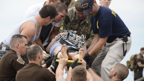 A woman is transported on a stretcher after she was rescued from the damaged medical center in Moore on May 20.