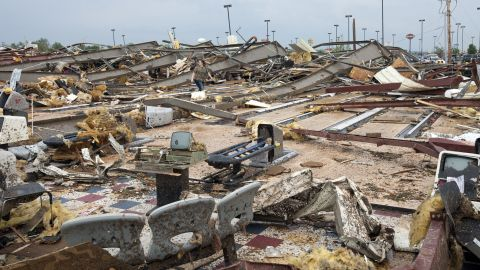 Image #: 22426817    A woman walks through debris after a huge tornado struck Moore, Oklahoma, near Oklahoma City, May 20, 2013. A massive tornado tore through the Oklahoma City suburb of Moore on Monday, killing at least 51 people as winds of up to 200 miles per hour (320 kph) flattened entire tracts of homes, two schools and a hospital, leaving a wake of tangled wreckage.    REUTERS/Richard Rowe (UNITED STATES - Tags: DISASTER ENVIRONMENT)       Reuters /STRINGER /LANDOV