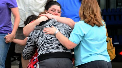 A woman is comforted after the May 20 tornado in Moore.