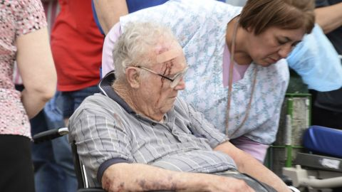 A nurse helps an older man who suffered a head injury on May 20 in Moore.