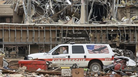 Image #: 22428027    A fire official drives through the rubble of Moore Medical Center after a tornado struck Moore, Oklahoma, May 20, 2013. A 2-mile-wide (3-km-wide) tornado tore through the Oklahoma City suburb of Moore on Monday, killing at least 51 people while destroying entire tracts of homes, piling cars atop one another, and trapping two dozen school children beneath rubble. REUTERS/Gene Blevins (UNITED STATES - Tags: ENVIRONMENT DISASTER)       REUTERS /GENE BLEVINS /LANDOV