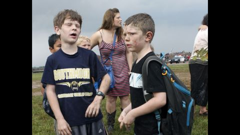 Children wait for their parents to arrive at Briarwood Elementary School in south Oklahoma City on May 20.