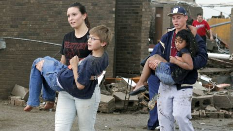 Teachers carry children away from Briarwood Elementary School on May 20.