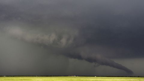 """A funnel cloud stretches toward the ground near South Haven, Kansas, on May 19. As many as<a href=""""http://www.cnn.com/2013/05/20/us/gallery/midwest-weather/index.html"""" target=""""_blank""""> 28 tornadoes were reported in Oklahoma, Kansas, Illinois and Iowa</a> on Sunday and Monday, according to the National Weather Service, with Oklahoma and Kansas the hardest-hit,<a href=""""http://www.cnn.com/2013/05/20/us/gallery/moore-oklahoma-tornado/index.html?hpt=hp_t1"""" target=""""_blank""""> including a EF4 storm that devastated Moore, Oklahoma</a>."""