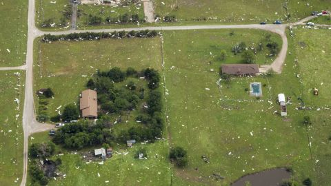 Debris from homes and structures was strewn for miles around.