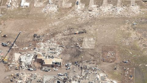 Rescuers and first responders immediately began searching through the rubble of structures on May 20.