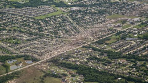 "View more galleries: <a href=""http://www.cnn.com/2013/05/20/us/gallery/moore-oklahoma-tornado/index.html"">Deadly tornado hits Oklahoma City area</a> and <a href=""http://www.cnn.com/2013/05/20/us/gallery/1999-oklahoma-tornado/index.html"">The devastating Oklahoma tornado of 1999</a>."