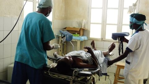 Doctors and staff at HEAL Africa explain to a patient what to expect as they prepare her for fistula surgery.