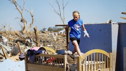 Casey Angle walks on the bunk bed she shared with her sister Sydney, who was among the students killed at Plaza Towers Elementary School during the tornado.