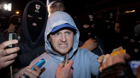 EDL leader Tommy Robinson joins supporters at the crime scene on May 22.