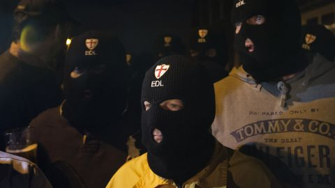 Members of the far-right English Defence League wear balaclavas as they gather outside a pub in Woolwich on Wednesday, May 22.