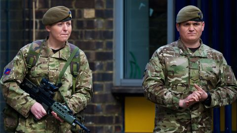 British soldiers stand guard outside the barracks on May 23.