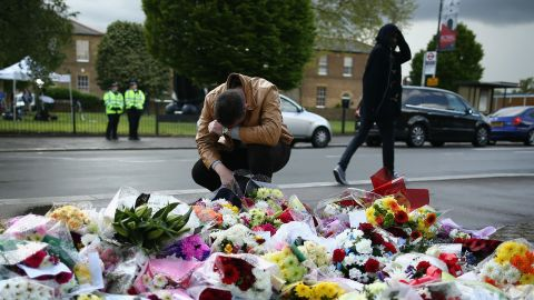 A man contemplates the makeshift memorial outside Woolwich Barracks in London.
