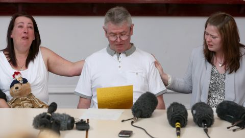 From left, Lyn Rigby, mother of the slain soldier, stepfather Ian Rigby and Lee's wife Rebecca Rigby grieve as Ian reads a family statement on Friday, May 24, in Bury, England.