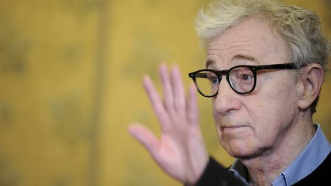 """US film director Woody Allen waves during the photocall of """"To Rome With Love"""" on April 13, 2012 at a hotel in Rome.  """"To Rome With Love"""" is directed by US Woody Allen.    AFP PHOTO / TIZIANA FABI (Photo credit should read TIZIANA FABI/AFP/Getty Images)"""