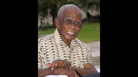 """James Sisnett was born February 22, 1900, in Barbados. He made it to 113 and believed he lived that long by eating good food; having a daily """"little one,"""" his name for an alcoholic drink; and """"God's grace."""" He worked as a blacksmith, a sugar factory worker and a farmer before retiring at age 70. His longevity made him a local celebrity. His only real health challenge toward the end of his life was hearing loss. He died in May 2013."""