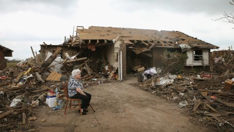 Eunice Lassiter sits in the driveway of a friend's tornado-damaged home on May 25 in Moore.