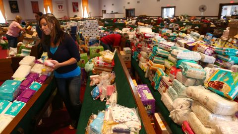 Volunteer Brittany Pendergraft organizes donated tornado relief items inside the Yellow Rose Theater on May 25 in Moore.