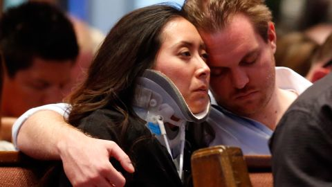 Plaza Towers Elementary School teacher Jennifer Doan is comforted by her fiance, Nyle Rogers, on May 26.