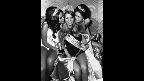 Marjorie Wallace lost her Miss World 1973 title because the organization said that dating celebrities like Tom Jones during her reign threatened its reputation. She had entered the pageant as Miss America. Pictured, Wallace celebrates with Miss Jamaica Patricia Yuen, left, and Miss Philippines Margarita Moran after she is crowned Miss World.