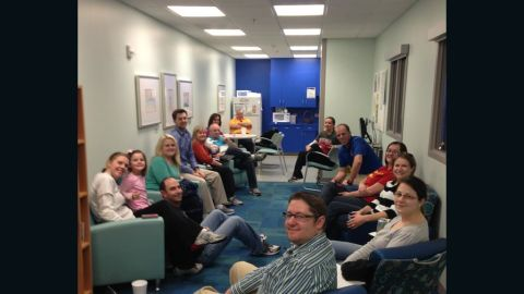 As Tripp is taken into surgery for his bacterial infection, relatives and family friends wait for news in the hospital.