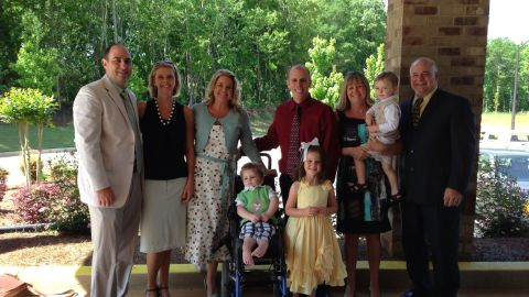 """Tripp, his parents and the extended family pose for a family photo in late spring. """"It was so awesome bringing Tripp home,"""" Halstead said. """"It's starting to feel like we are putting our lives back together."""""""