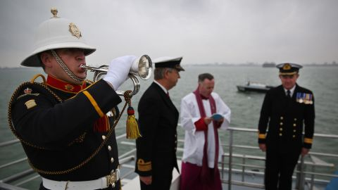 Royal Marine Bugler Dave Nevatte plays the Last Post during a wreath laying ceremony.