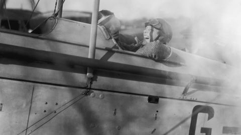 Amelia Earhart laughs before a flight to Northolt, England, in a DH 82 Tiger Moth plane on June 24, 1928.
